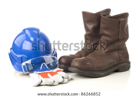 A set of protective equipment such as hard hat, safety glass, semi leather gloves and safety shoes isolated with white background - stock photo