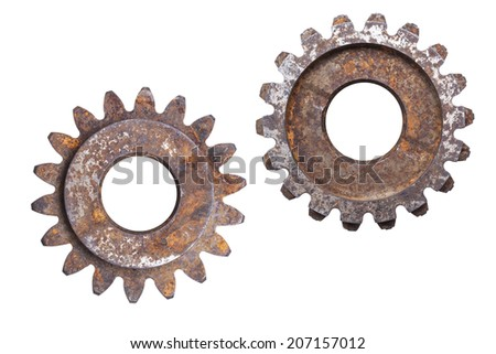 A set of two over-sized rusty metal gears isolated on a white background. - stock photo