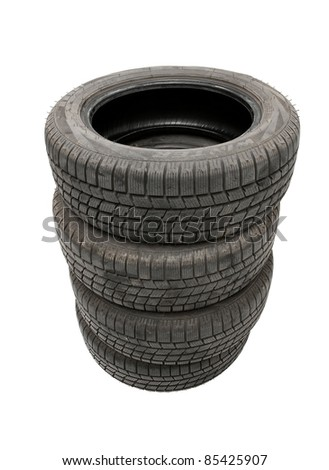 A set of winter tyres in a pile - stock photo