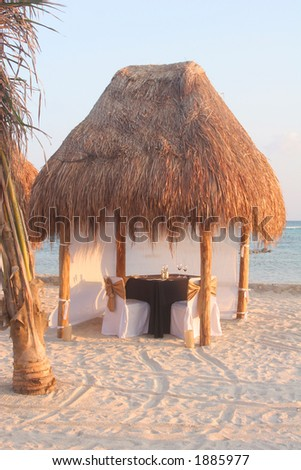A setting for a romantic dinner on the beach.
