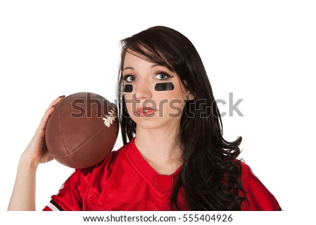 A sexy female holding a football in a jersey