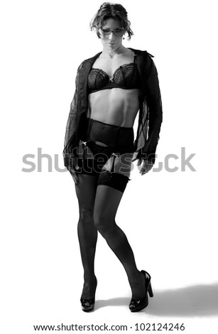A sexy schoolteacher in black lingerie and heels - stock photo