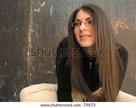 A sexy woman outside in New York City, having lots of fun - stock photo
