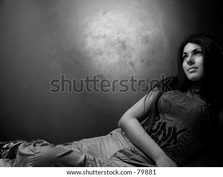 A sexy woman stares into the distance - stock photo