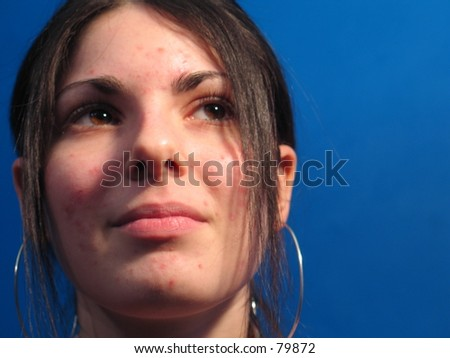 A sexy woman with a katana stares into the distance - stock photo