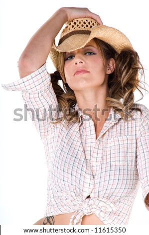 A sexy young cowgirl with pigtails - stock photo
