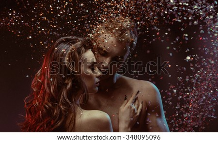 A sexy young topless couple - stock photo