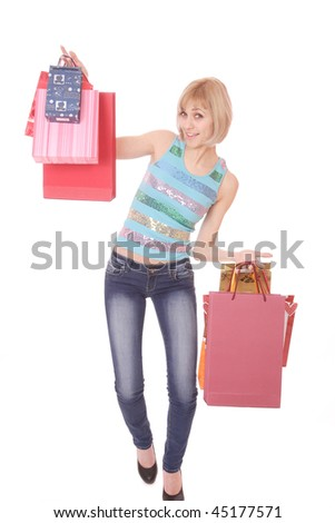 A sexy young woman with a bunch of shopping bags