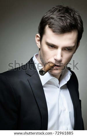 A shady character with a cigar and a suit - stock photo