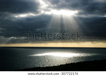 A shaft of light through the clouds.  Provides imagery of hope, faith, religion - stock photo