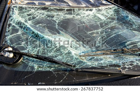A shattered windshield from a crashed car.