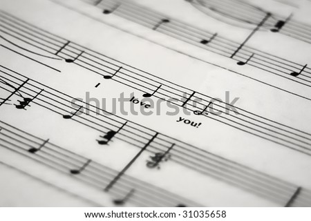 a sheet of music with the lyric I love you - stock photo