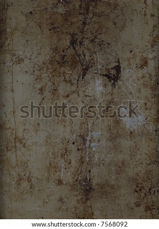 A sheet of rusted, stained and scratched metal, suitable as a background texture. - stock photo