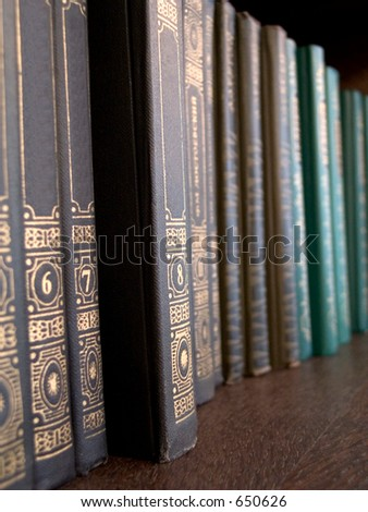 A shelf of old books - stock photo