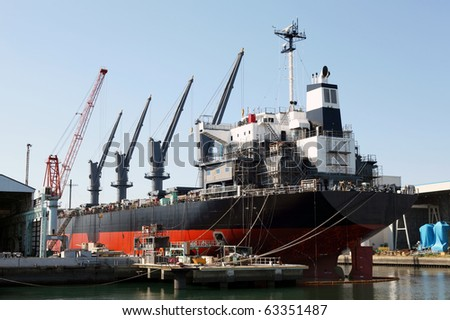 A ship in a dry dock - stock photo