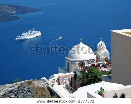 A ship in Santorini doing a cruise on the Greek Islands - stock photo