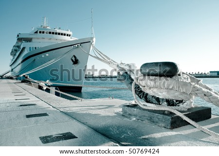 A ship moored in port. - stock photo