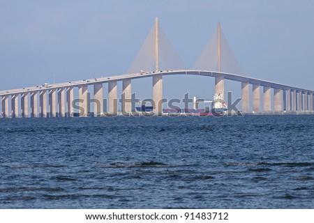 A ship passing under the Bob Graham Sunshine Skyway Bridge.This bridge spans Tampa Bay,connecting St.Petersburg and Terra Ceia,Florida. - stock photo