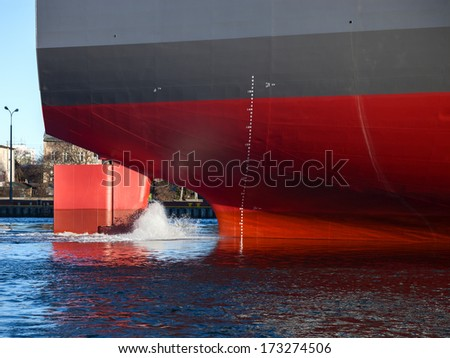 A ship stern on a working harbour. - stock photo