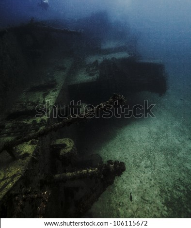 A shipwreck laying on its side underwater in the John Pennekamp State Park in Key Largo, Florida. An artificial reef created by the USCG Bibb. - stock photo