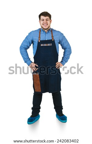 A shoot of young caucasian men in apron as a barmen with arms akimbo. Isolated against white background. - stock photo