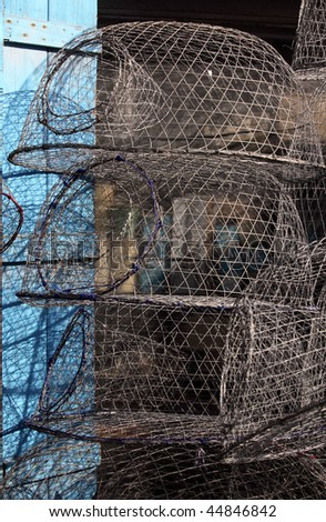 A shop on the harbour side of  Qatar's Souq Waqif selling the wire mesh traps that are used by the fishing dhows. Once a fish swims down the tube to the bait it is unlikely to find its way out again - stock photo
