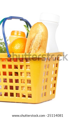 A shopping basket full of groceries isolated on white background - stock photo