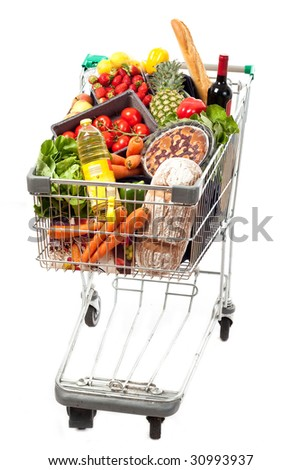 A shopping cart full of groceries on a white background - stock photo