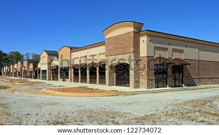 A shopping center under construction is abandoned in a poor economy. - stock photo