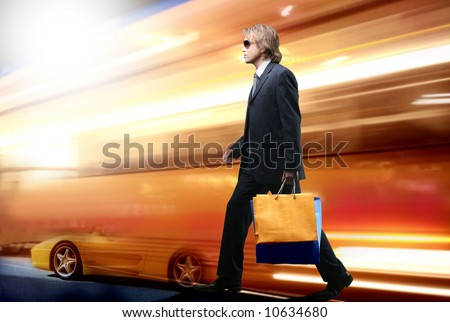 a shopping man in the city - stock photo