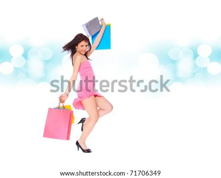 a Shopping sexy woman over blue bokeh background - stock photo