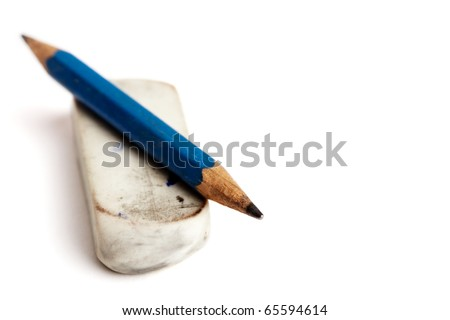 A short cutted pencil on an old rubber / eraser over white backround - stock photo