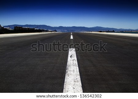 A shot of a airport runway in Gibraltar - stock photo