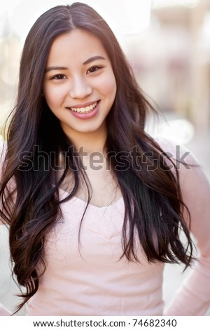 A shot of a beautiful asian woman outdoor - stock photo