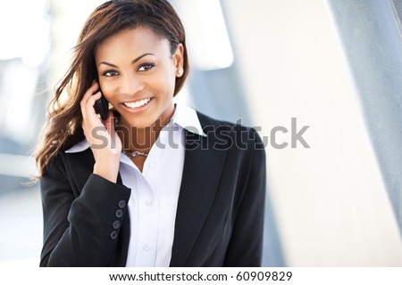 A shot of a beautiful black businesswoman on the phone - stock photo