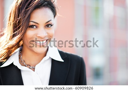 A shot of a beautiful black businesswoman outdoor