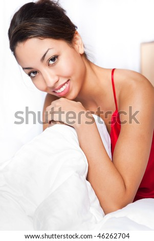 A shot of a beautiful black woman on her bed
