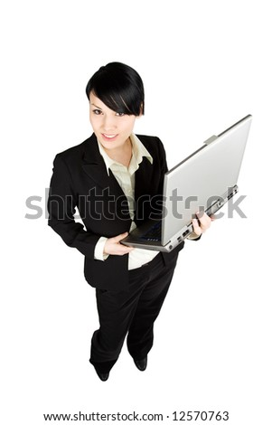 A shot of a beautiful businesswoman holding a laptop - stock photo