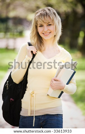 A shot of a beautiful caucasian college student on campus - stock photo