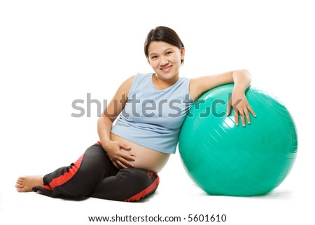 A shot of a beautiful pregnant woman with an exercise ball