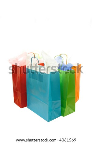 A shot of a bunch of isolated colorful shopping bags - stock photo