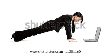 A shot of a businesswoman doing pushup while working on her laptop - stock photo
