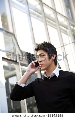 A shot of a casual asian businessman talking on the phone - stock photo