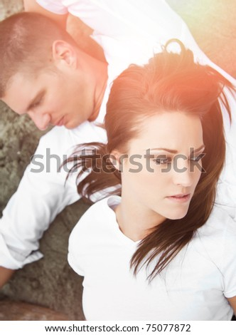 A shot of a Caucasian couple having a fight - stock photo