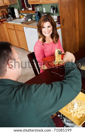 A shot of a caucasian couple having dinner at home