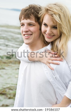 A shot of a caucasian couple on the beach