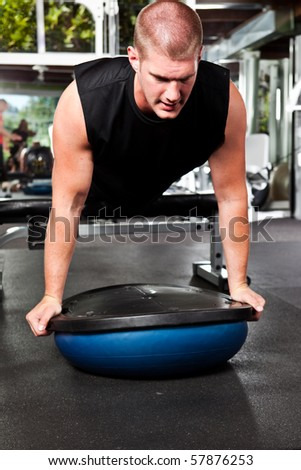 A shot of a caucasian male athlete training and doing push-up