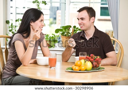A shot of a couple eating their breakfast at home