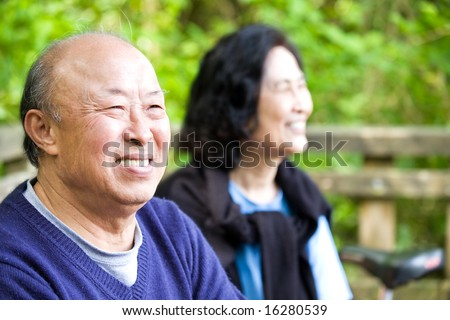 A shot of a couple of happy asian senior outdoor - stock photo