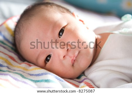 A shot of a cute asian baby boy